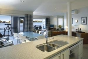 A kitchen or kitchenette at The Waterfront Suites - Heritage Collection
