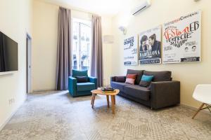 A seating area at Uma Suites Pau Claris