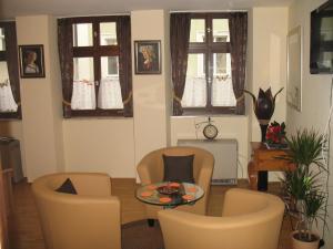 Ein Sitzbereich in der Unterkunft Ferienwohnungen Rockefeller Zentrum Bamberg