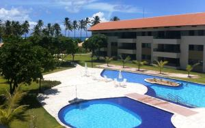 A view of the pool at Carneiros Beach Resort or nearby