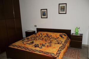 A bed or beds in a room at Villa Regina Enrica
