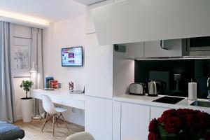 A kitchen or kitchenette at Lou Lou Apart