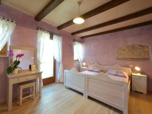 A bed or beds in a room at Istrian Villa Fumica