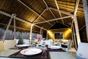 Restaurant ou autre lieu de restauration dans l'établissement Sunset Palms Resort