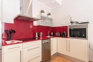 A kitchen or kitchenette at Pelayo Deluxe Apartments