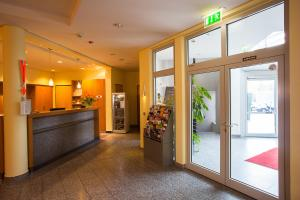 The lobby or reception area at Aparion Apartments Berlin Family