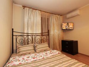 Кровать или кровати в номере ApartLux Алтуфьево