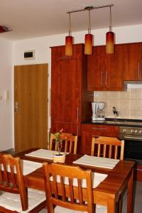 A kitchen or kitchenette at Blanca Apartman