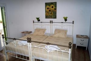 A bed or beds in a room at Maria & Kyros House