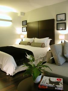 A bed or beds in a room at Atelier Apartments by BridgeStreet
