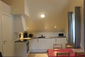 A kitchen or kitchenette at Brekke Apartments