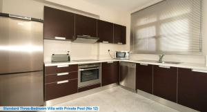 A kitchen or kitchenette at Amathusa Villas