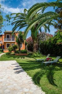 A garden outside Folies Corfu Town Hotel Apartments