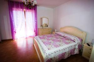 Letto o letti in una camera di Casa Vacanze San Lorenzo