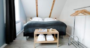 A bed or beds in a room at Old Charm Reykjavik Apartments