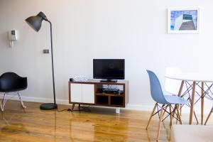 A television and/or entertainment center at Oporto Trendy Apartments