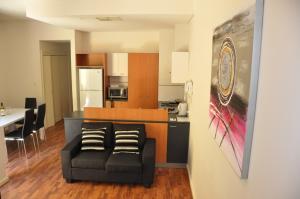 A kitchen or kitchenette at RNR Serviced Apartments Adelaide - Sturt St