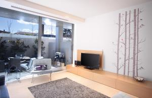 A television and/or entertainment center at Boutique Stays - The Residence, Brighton Luxury Apartment