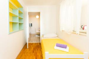 A bed or beds in a room at Apartments Noa