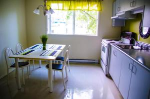 A kitchen or kitchenette at Les Résidences du Campus