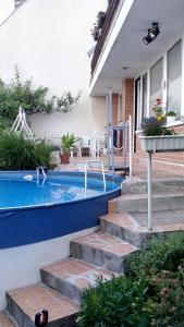 The swimming pool at or near Buda Garden Apartment