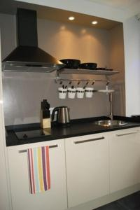 A kitchen or kitchenette at Appartement Censier Daubenton