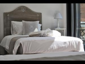 Vuode tai vuoteita majoituspaikassa Le charme de Bordeaux