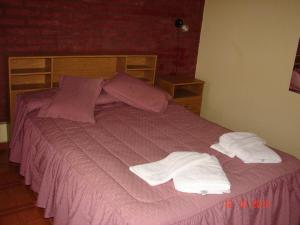 A bed or beds in a room at El Nogal