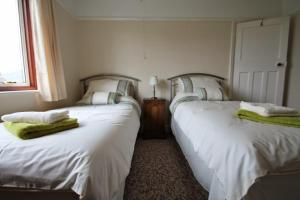 A bed or beds in a room at Greenways