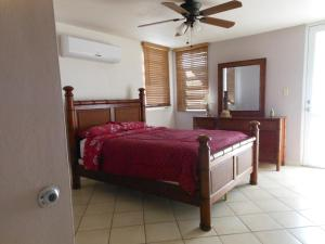 A bed or beds in a room at Puerto Rico Seaside House