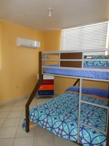 A bunk bed or bunk beds in a room at Puerto Rico Seaside House