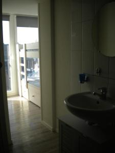 A bathroom at Apartment Sandeman