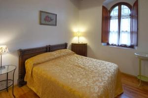 A bed or beds in a room at Apartment Florence -Charme and relax