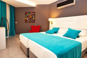 A bed or beds in a room at Green Garden Suites Hotel