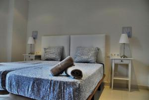 A bed or beds in a room at Apartaments Can Negret