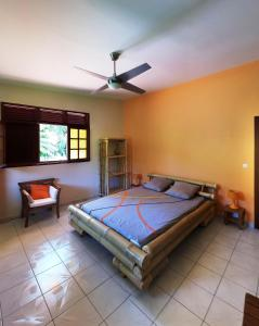 A bed or beds in a room at Domaine du Piton Bellevue