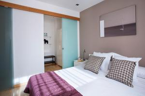A bed or beds in a room at Durlet Rambla Mar Apartments