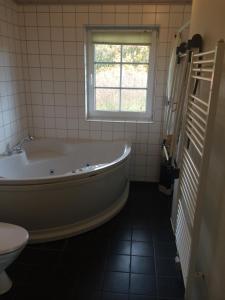 A bathroom at Lønne Feriepark Holiday House 53