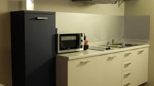A kitchen or kitchenette at San Marco Holidays
