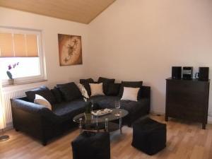 Ein Sitzbereich in der Unterkunft Ferienwohnung Beni