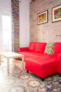 A seating area at Apartment Poble Sec