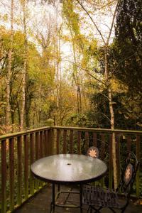 A balcony or terrace at Pinetum Lodge