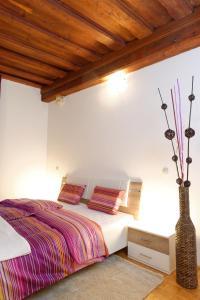 Postelja oz. postelje v sobi nastanitve Ljubljana Center Apartments