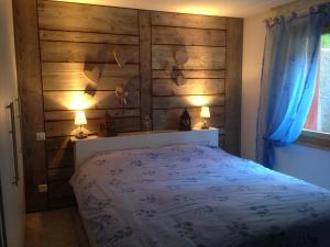 Un ou plusieurs lits dans un hébergement de l'établissement Résidence les Bouquetins