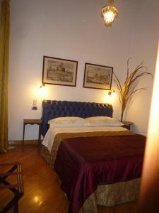 A bed or beds in a room at Residenza Mucha