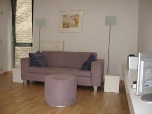 Et sittehjørne på Design Apartment Pandreitje Brugge