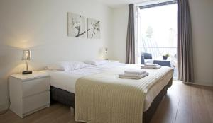 A bed or beds in a room at Stayci Serviced Apartments Grand Place