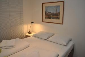 A bed or beds in a room at Loft Apartment