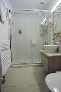 A bathroom at Frixos Suites Hotel Apartments