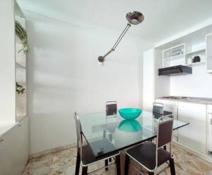 A kitchen or kitchenette at Flat Rossi